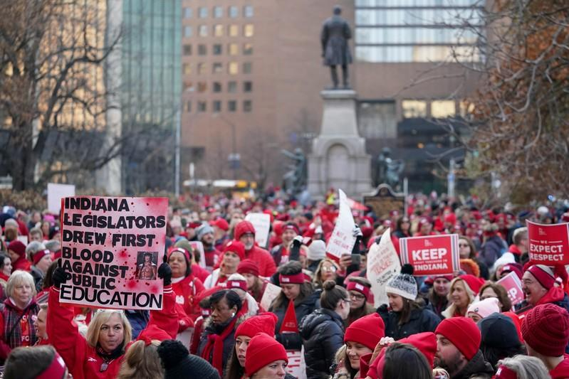 People gather as teachers hold a one day walkout at the statehouse in Indianapolis