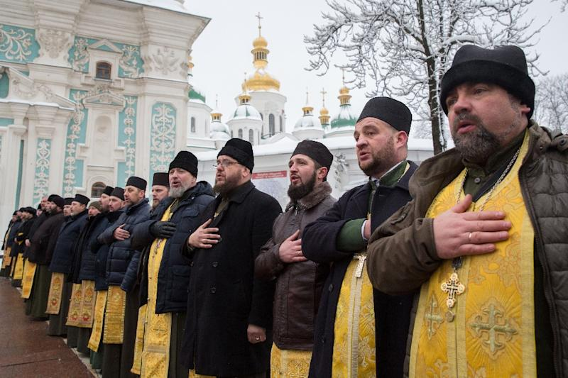 Outside Kiev's 11th-century Saint Sophia Cathedral, priests said prayers while thousands of worshippers gathered ahead of the historic decision (AFP Photo/Mykhaylo MARKIV)
