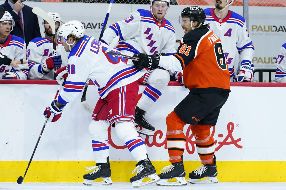 Philadelphia Flyers' Carsen Twarynski (81) collides with New York Rangers' Brendan Lemieux (48) during the second period of an NHL hockey game, Wednesday, Feb. 24, 2021, in Philadelphia. (AP Photo/Matt Slocum)