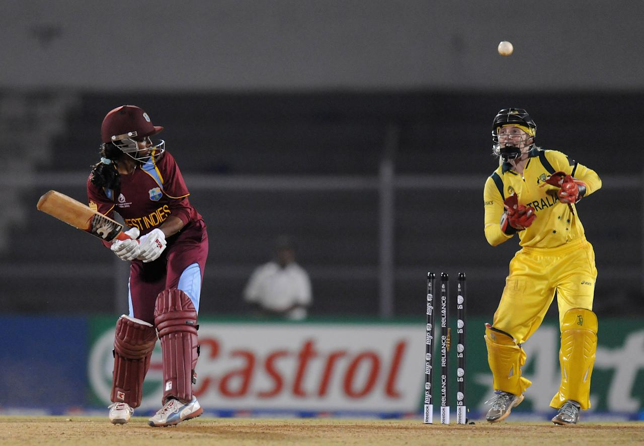 MUMBAI, INDIA - FEBRUARY 17:  Merissa Aguilleira captain of West Indies gets bowled out by Lisa Sthalekar of Australia during the final between Australia and West Indies held at the CCI (Cricket Club of India) stadium on February 17, 2013 in Mumbai, India.  (Photo by Pal Pillai/Getty Images)