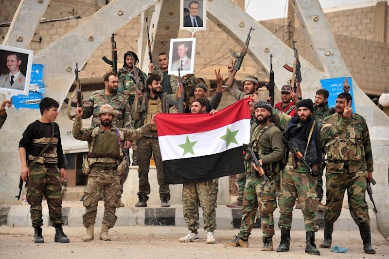 A handout picture released by Syrian state news agency SANA on November 21, 2017 shows pro-government celebrating after capturing from IS Albu Kamal, the group's last major urban stronghold in Syria (AFP Photo/Handout / STR)