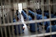 Inmates sit on the floor during an inspection visit in the long term sentence zone inside Klong Prem high-security prison in Bangkok, Thailand July 12, 2016. REUTERS/Jorge Silva