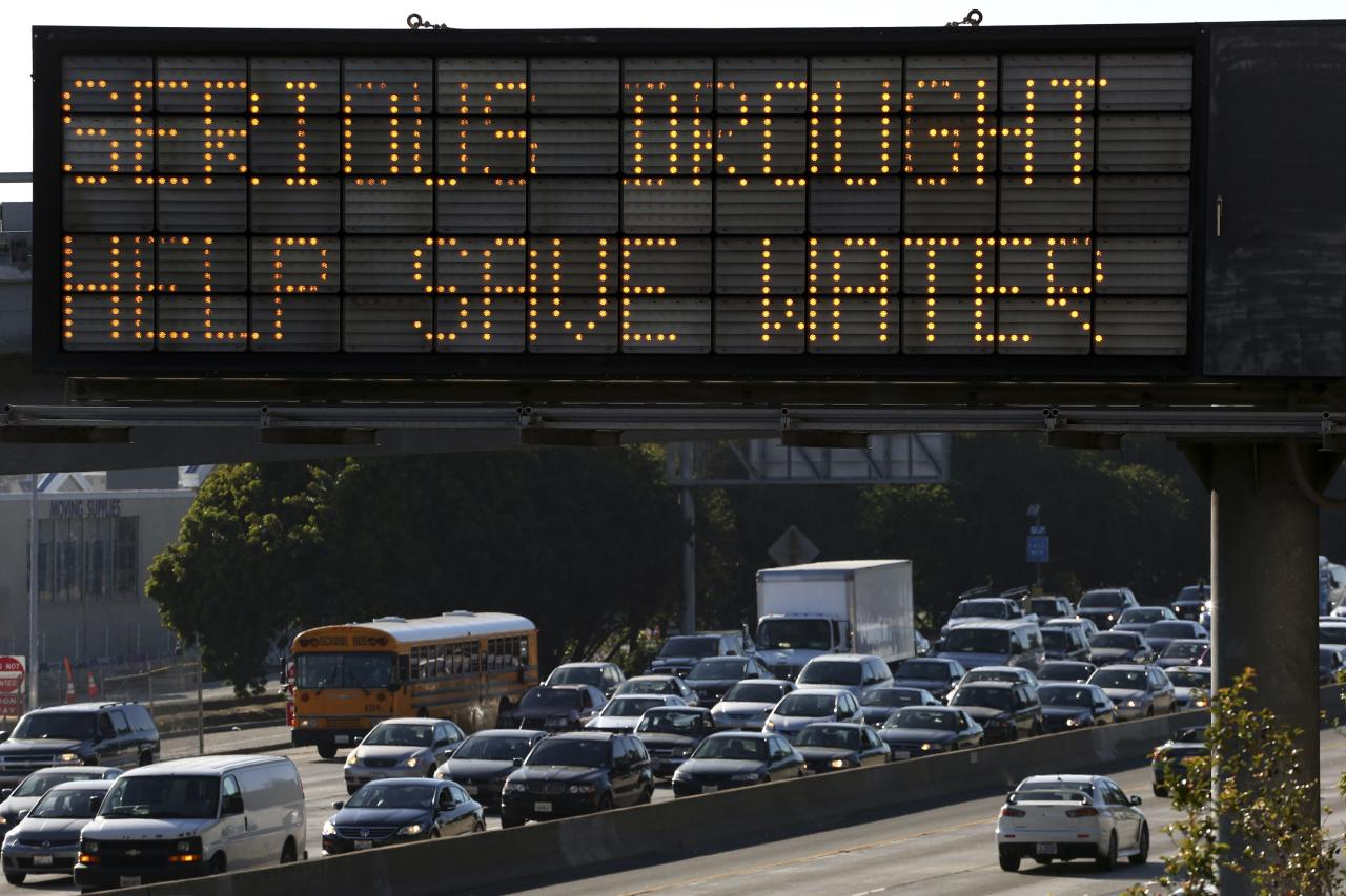 A Caltrans information sign urges drivers to save water due to the California drought emergency in Los Angeles, California in this February 13, 2014 file photo. As California struggles through its third year of drought, nearly half of state residents said they would be willing to pay higher water bills to ensure a more stable supply, a new poll showed on June 6, 2014. REUTERS/Jonathan Alcorn/Files (UNITED STATES - Tags: ENVIRONMENT DISASTER)