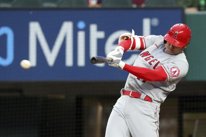 Los Angeles Angels' Shohei Ohtani (17) connects for a two-RBI double in the second inning against the Texas Rangers during a baseball game on Monday, April 26, 2021, in Arlington, Texas. (AP Photo/Richard W. Rodriguez)