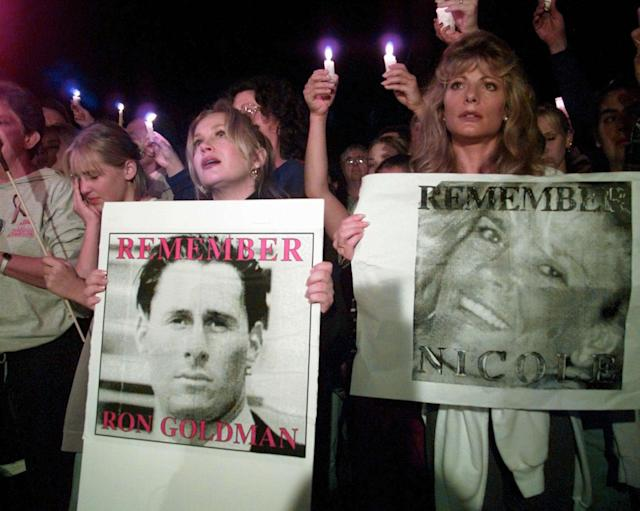 <p>Charlene Tilton, left, and Cindy Josten hold posters of murder victims Nicole Brown Simpson and Ronald Goldman, some of the more than 2,000 participants in a candlelight march to pass by Nicole Brown Simpson's condominium on Sat., Oct. 7, 1995 in Los Angeles, Calif. (Photo: Eric Draper/AP) </p>