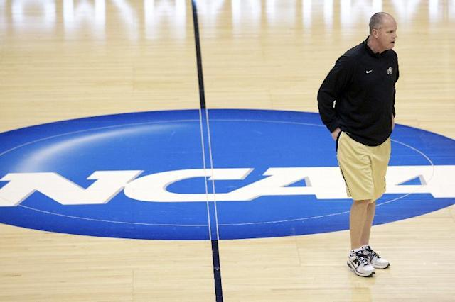Colorado head coach Tad Boyle watches his team practice for an NCAA college basketball tournament game in Orlando, Fla., Wednesday, March 19, 2014. Colorado will face Pittsburgh in a second round game on Thursday. (AP Photo/Phelan M. Ebenhack)