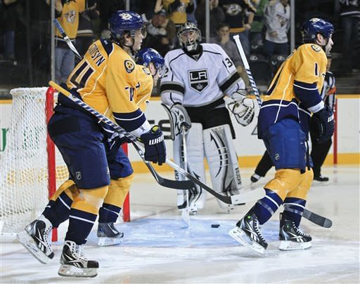 Nashville Predators players Sergei Kostitsyn (74), of Belarus; Patric Hornqvist (27), of Sweden, second from left; and David Legwand (11), right, skate past Los Angeles Kings goalie Jonathan Quick (32) after Hornqvist scored in the second period of an NHL hockey game on Monday, Feb. 27, 2012, in Nashville, Tenn. (AP Photo/Mark Humphrey)