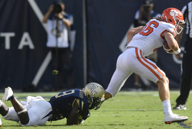 Georgia Tech linebacker Victor Alexander (9) tackles Clemson quarterback Trevor Lawrence (16) during the first half of an NCAA college football game, Saturday, Sept. 22, 2018, in Atlanta. (AP Photo/Mike Stewart)