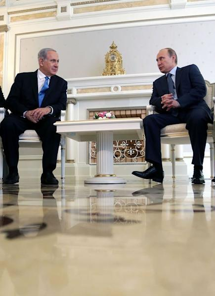 Russia's President Vladimir Putin (R) and Israeli Prime Minister Benjamin Netanyahu meet in Sochi, on May 14, 2013. The two leaders discussed the conflict in Syria as concern grew about Moscow's arms deliveries to the Damascus regime and a spiralling death toll