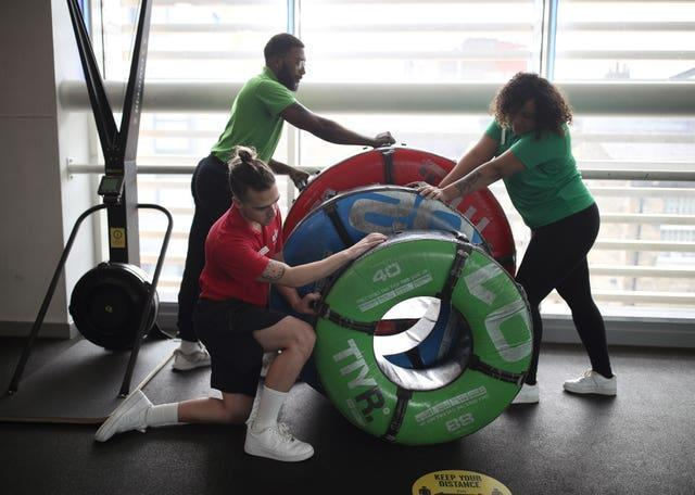 Staff at Clapham Leisure Centre in south London ready the gym facilities for reopening