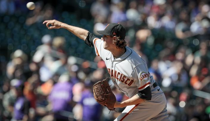San Francisco Giants starting pitcher Kevin Gausman delivers in the first inning of a baseball game against the Colorado Rockies in Denver, Sunday, Sept. 26, 2021. (AP Photo/Joe Mahoney)