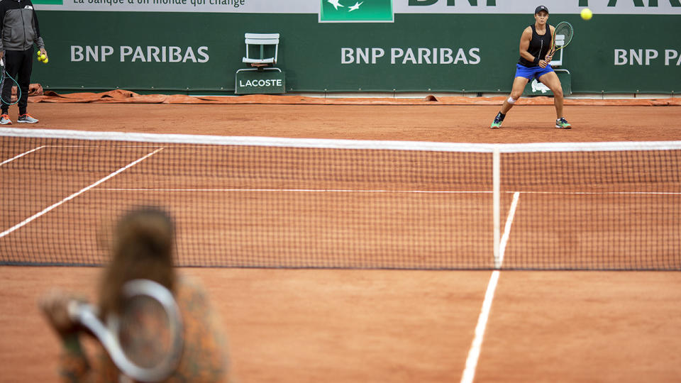Naomi Osaka and Ash Barty, pictured here together on Court Philippe-Chatrier.