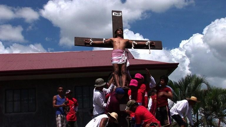 """SHOTLIST:                      +WARNING: CONTAIN GRAPHIC IMAGES OF MOCK CRUCIFIXIONS+                     SAN FERNANDO, PHILIPPINES, MAR 29, 2013, SOURCE: AFPTV                     - Men perform penance in the streets                     - CU of their bloody backs as they whip themselves                      SOUNDBITE 1 Edwin Marin (man), Catholic who performs penance (Tagalog, 10 sec):                     """"We whipped our back as part of our penance not only to be seen, but it is our prayer.""""                     -VAR men performing penance                     SOUNDBITE 2 Maritess Quintanar (woman), Catholic (Tagalog, 12 sec):                     """"We will see how Jesus Christ was crucified, and feel his hardships. That's what we want to impart to our children.""""                     - A man carries a cross through the streets                     - Two men approach the hill staging three crosses                      - VAR man being nailed to a cross                     SOUNDBITE 3 Charlotte Johansen (woman), Norwegian living in Manila (English, 8 sec):                     """"I find it very fascinating that someone will go to that length or subject himself to that kind of pain because of their religious beliefs and tradition.""""                      - VAR man on a cross                     ///                     ----------------------------------------------------                     AFP TEXT STORY:                     Easter-Philippines-religious-crucifixion,lead                      Philippines marks Easter with bloody mock crucifixions                      by Noel Celis                      SAN FERNANDO, Philippines, March 29, 2013 (AFP) - Catholic zealots in the Philippines re-enacted the last hours of Jesus Christ on Good Friday, whipping their backs and nailing themselves to crosses in a grisly Easter ritual that persists despite Church disapproval.                      Foreign and local tourists flocked to the outskirts of the city of San Fernando, a 90-minute drive """