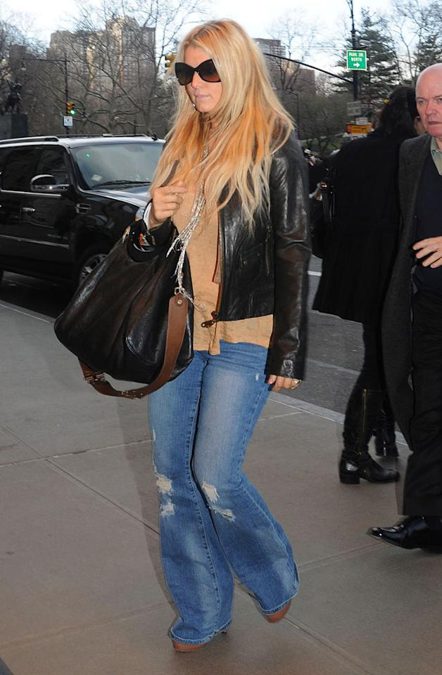 """We're doubting that the holes in Jessica Simpson's jeans were from real-life wear and tear. The stars like to buy their denim pre-tattered! Arnaldo Magnani/<a href=""""http://www.gettyimages.com/"""" target=""""new"""">GettyImages.com</a> - March 25, 2011"""