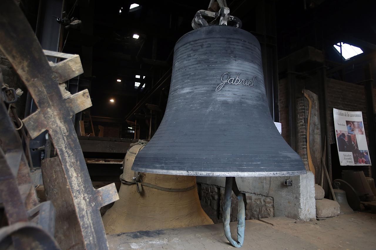 """A new bell bound for Notre Dame cathedral in Paris,""""Gabriel"""" is seen Friday, Dec. 7, 2012, after being cast in the foundry of Villedieu les Poeles, Normandy, France. Paris' Notre Dame Cathedral will be celebrating its 850th anniversary starting Wednesday Dec. 12, 2012, and Gabriel will join the peal of bells at the medieval landmark cathedral. (AP Photo/David Vincent)"""