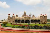 The current structure was constructed between 1897 and 1912, after the Old Palace was burnt ablaze. The last palace, now known as the Old Palace or the Wooden Palace, was burnt into ashes during the 1896 Dasara festivities.