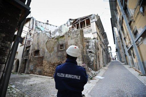 A policeman stands in April 2012 near the 'red zone' closed to public, in the historic area of L'Aquila devastated three years previous by an earthquake. Six Italian scientists and a government official were sentenced to six years in jail on Monday for multiple manslaughter in a watershed ruling that found them guilty of underestimating the risks of a killer earthquake in 2009