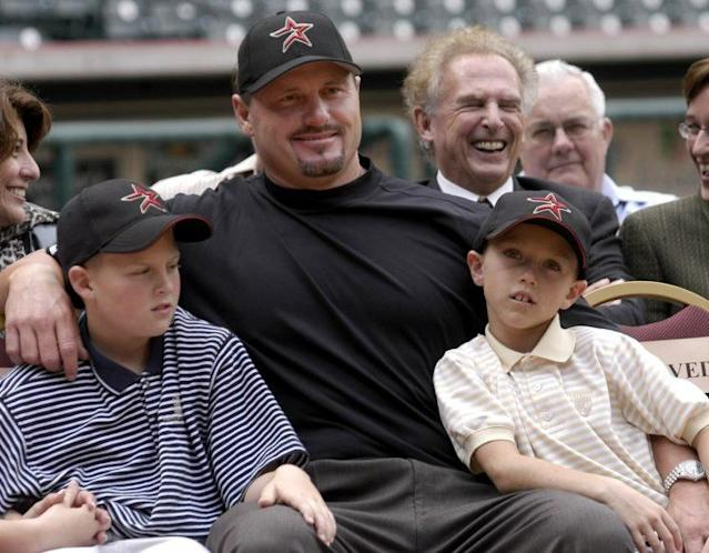 Kacy Clemens, left, with dad Roger Clemens and brother Kody in 2005. (AP)