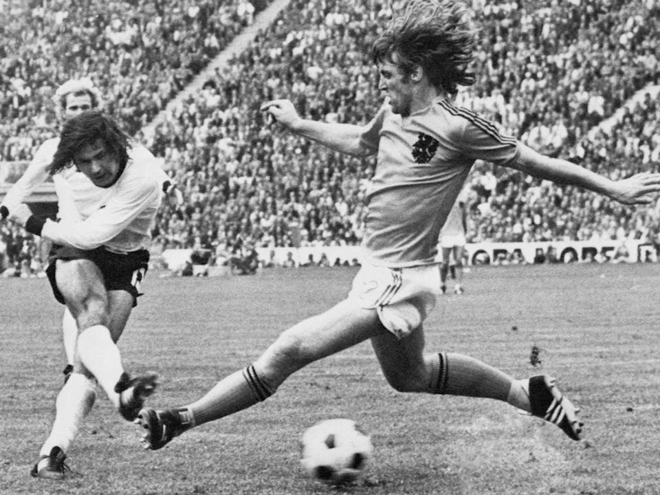 Muller shoots through the legs of the Netherlands' Rudi Krol to make it 2-1 in the 1974 final in Munich  (AFP/Getty)