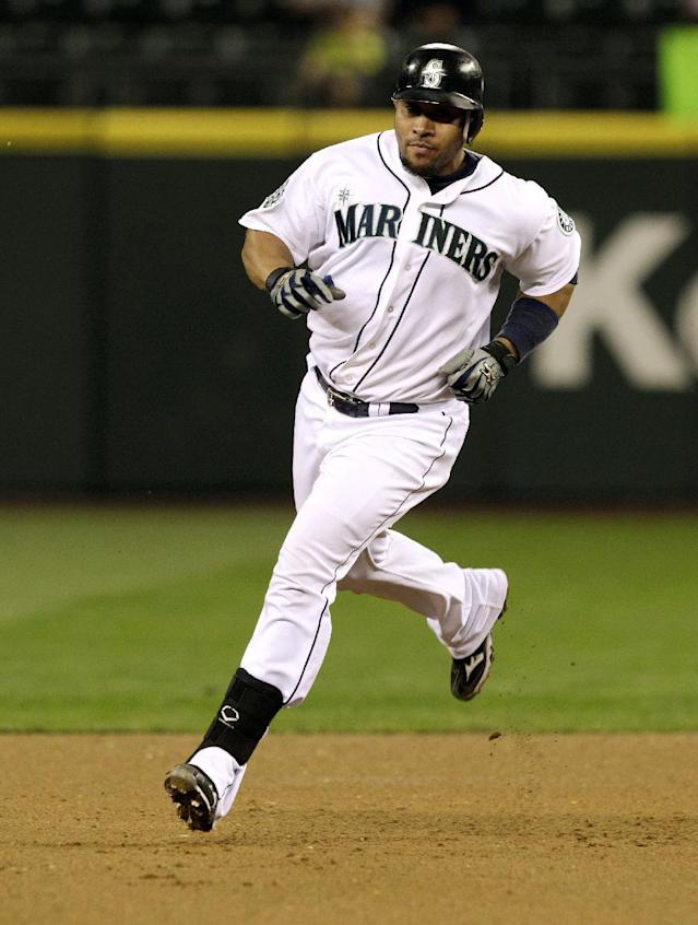 Seattle Mariners' Miguel Olivo rounds the bases after he hit a two-run home run against the Baltimore Orioles in the fourth inning of a baseball game, Tuesday, Sept. 18, 2012, in Seattle. (AP Photo/Ted S. Warren)
