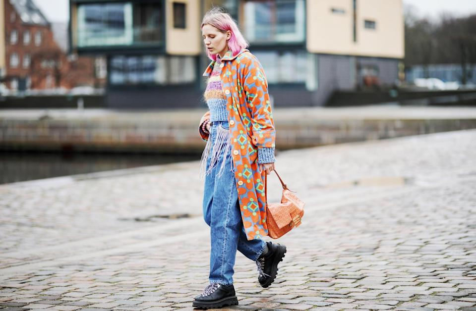 <p>Chunky boots and a colorful sweater and jacket bring a pair of baggy jeans to life. </p>