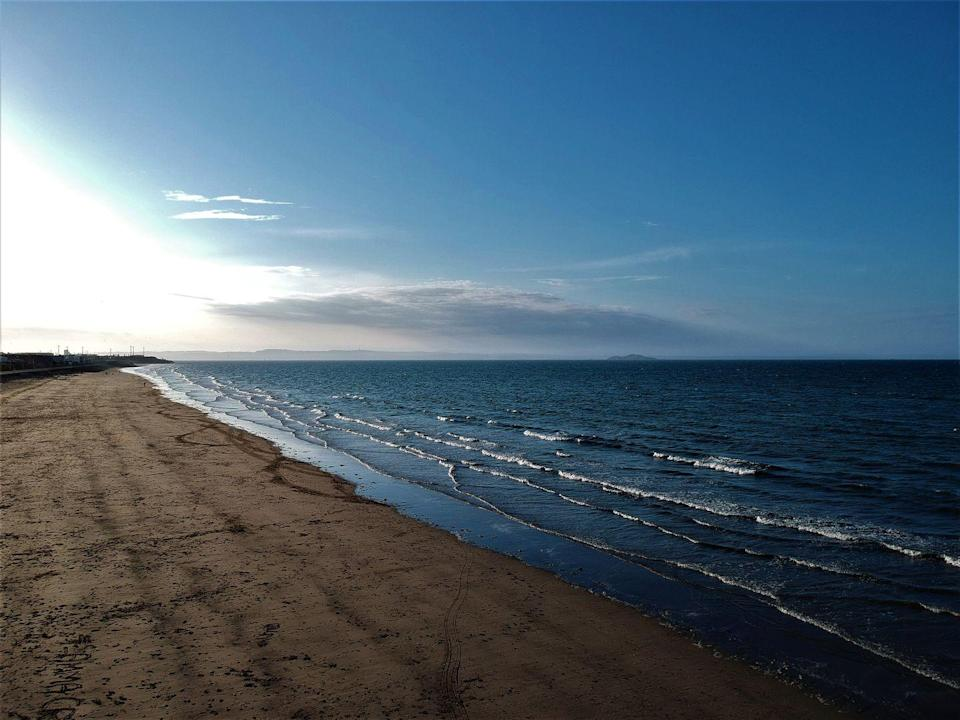 """<p>A few minutes out of town, <a href=""""https://www.visitscotland.com/"""" rel=""""nofollow noopener"""" target=""""_blank"""" data-ylk=""""slk:Portobello Beach"""" class=""""link rapid-noclick-resp"""">Portobello Beach</a> boasts two miles of (occasional) sun, sand and sea. Wild swimmers can brave the Firth of Forth. </p>"""