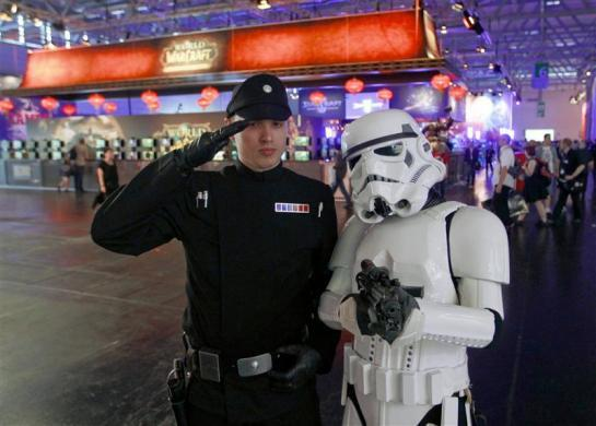 Visitors dressed as 'Star Wars' characters pose during the Gamescom 2012 fair in Cologne August 15, 2012.