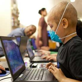 A young cancer patient plays Re-Mission 2: Nanobot's Revenge in a waiting room at Lucile Packard Children's Hospital in Palo Alto, Calif.