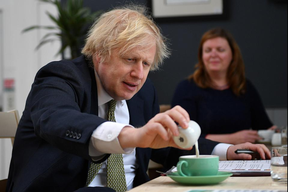 <p>Would you deign to warm your brew in the microwave?</p> (Getty Images)