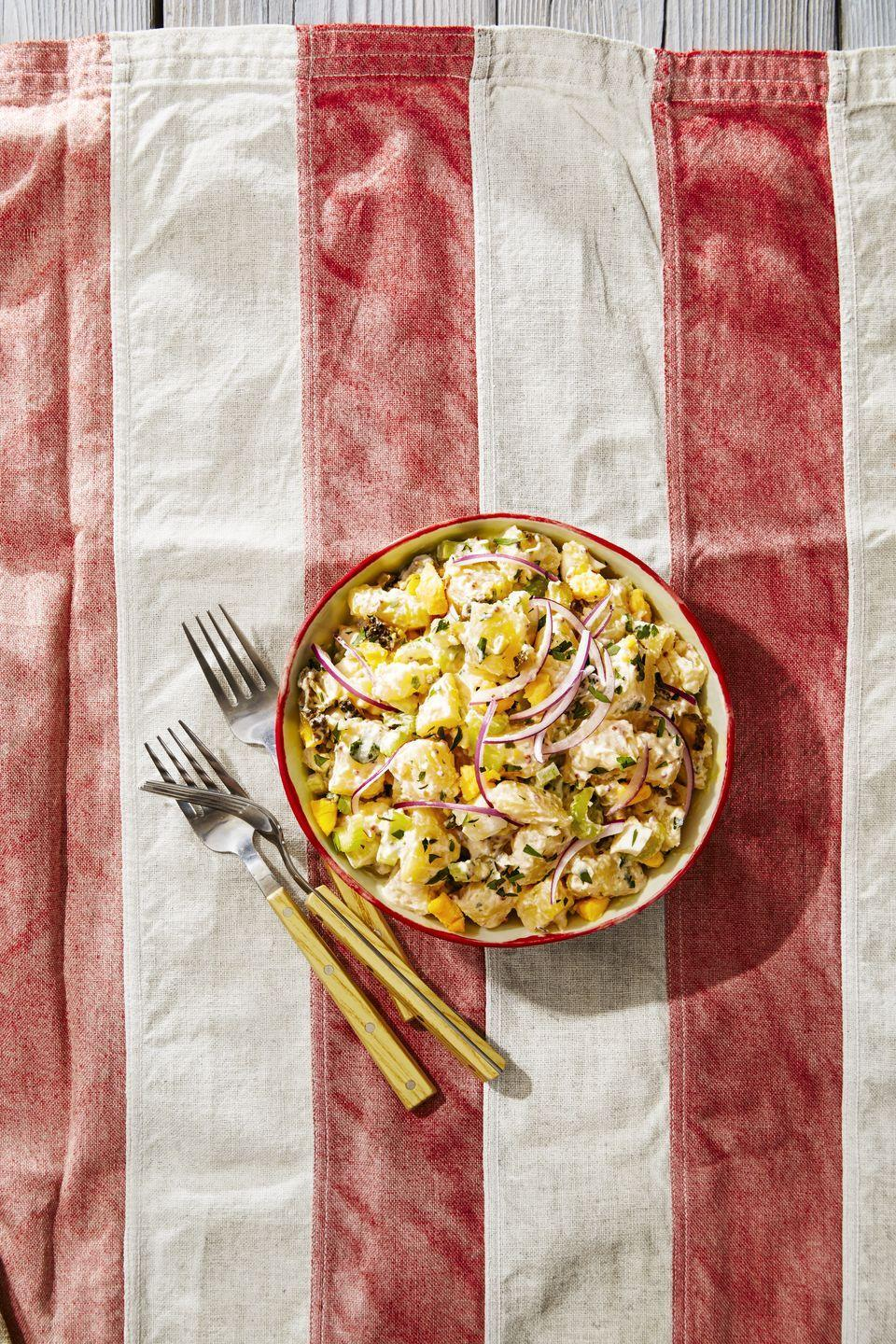 """<p> We lightened up the mayo-laden picnic favorite with yogurt and lots of fresh herbs. Plus, cornichons folded into a BBQ fave add a salty, pickly bite.</p><p><em><a href=""""https://www.goodhousekeeping.com/food-recipes/a39275/parisian-potato-salad-recipe/"""" rel=""""nofollow noopener"""" target=""""_blank"""" data-ylk=""""slk:Get the recipe for Parisian Potato Salad »"""" class=""""link rapid-noclick-resp"""">Get the recipe for Parisian Potato Salad »</a></em></p>"""
