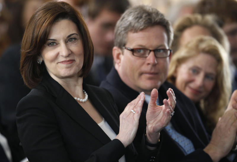 Victoria Reggie Kennedy, widow of Sen. Edward M. Kennedy, left, applauds with the late Senator's son Edward M. Kennedy', Jr., center, and his wife Kiki Kennedy, right, during groundbreaking ceremonies for the new Edward M. Kennedy Institute for the United States Senate, in Boston, Friday, April 8, 2010. Friday's ceremony was held on a site next to the John F. Kennedy Library and Museum. (AP Photo/Steven Senne)