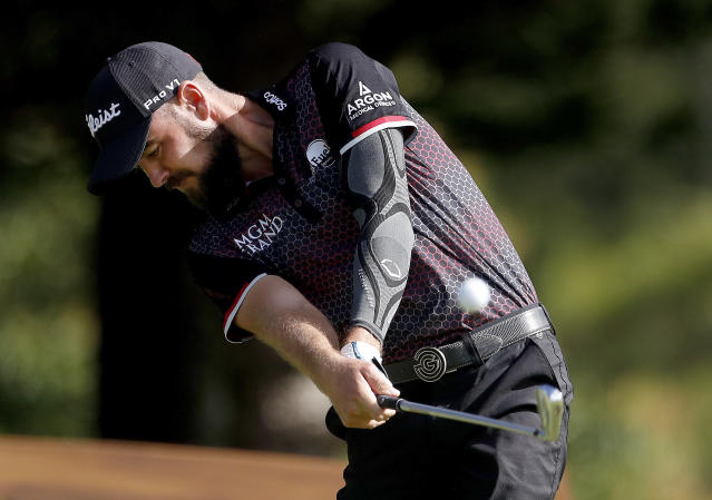 Troy Merritt plays his shot from the second tee during the first round of the Tournament of Champions golf event, Thursday, Jan. 3, 2019, at Kapalua Plantation Course in Kapalua, Hawaii. (AP Photo/Matt York)