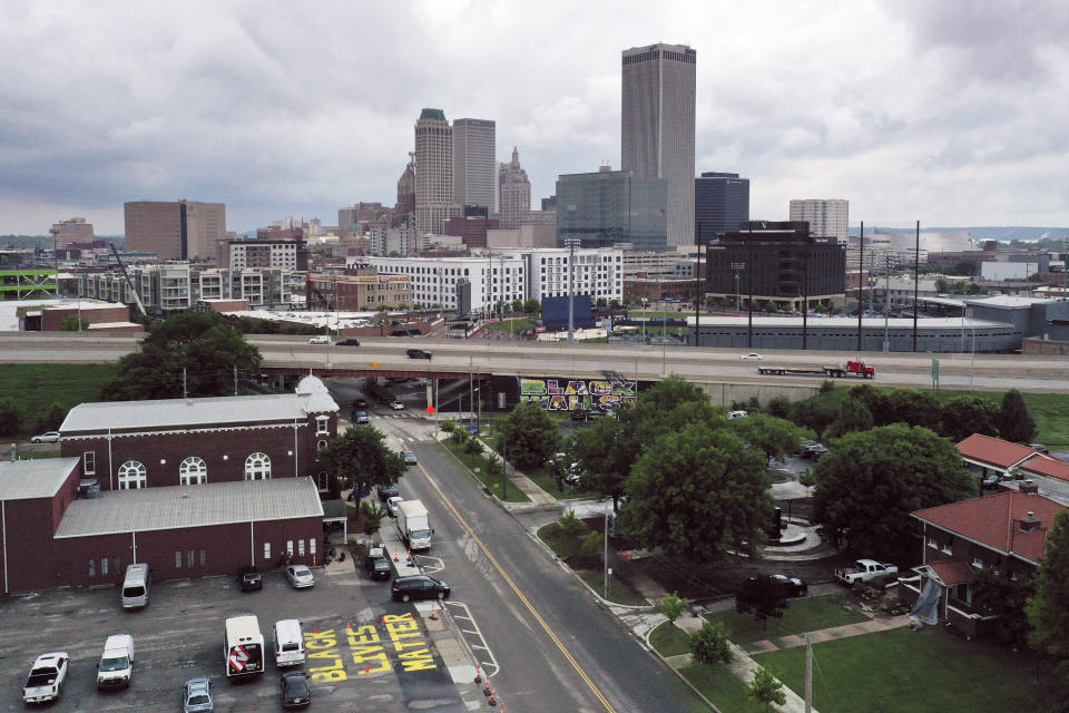 With the Historic Vernon African Methodist Episcopal Church at foreground left, Interstate 244 cuts through the middle of historic Greenwood neighborhood of Tulsa, Okla., on Monday, May 24, 2021. Over 18 hours, between May 31 and June 1, 1921 whites vastly outnumbering the Black militia carried out a scorched-earth campaign against the Greenwood neighborhood. Nearly every structure in Greenwood, the fabled Black Wall Street, was flattened - aside from Vernon AME. (AP Photo/Sue Ogrocki)