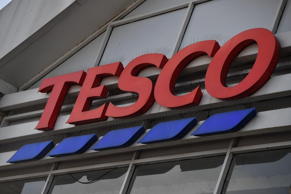 Signage for British supermarket chain Tesco at a store in south London on June 15, 2018.