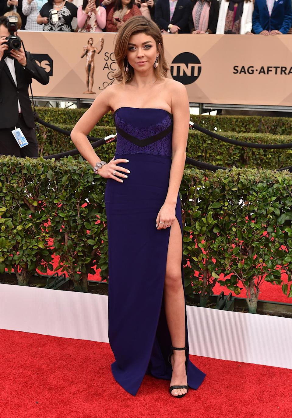"""<p>Sarah Hyland, wearing a J. Mendel gown with a thigh-high slit, described her look as """"Angliena Joleg."""" Hiding underneath the number is a new tattoo that says """"follow my heartbeat"""" from the musical <i>Hair</i>, which she performed in at the Hollywood Bowl, and is situated in the """"underboob"""" area. She accessorized with Lorraine Schwartz and Ofira jewelry. <i>Photo: AP</i></p>"""