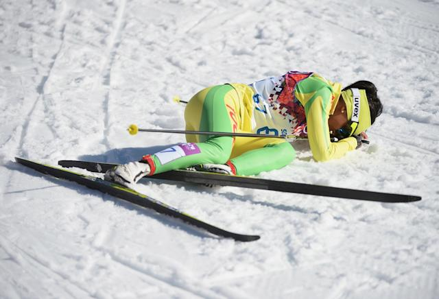 SOCHI, RUSSIA - FEBRUARY 13: Mathilde Amivi Petitjean of Togo collapses at the finish line in the Women's 10 km Classic during day six of the Sochi 2014 Winter Olympics at Laura Cross-country Ski & Biathlon Center on February 13, 2014 in Sochi, Russia. (Photo by Harry How/Getty Images)