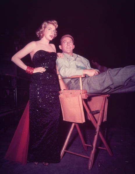 <p>Rosemary Clooney catches up with her costar, Bing Crosby, who's casually reclining in a director's chair, in-between filming scenes for <em>White Christmas</em>.  </p>