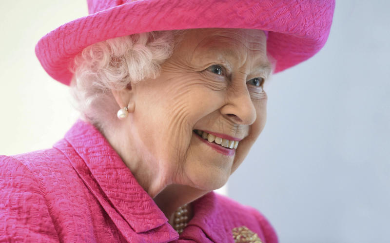 Britain's Queen Elizabeth II reacts during a visit to the Royal Papworth Hospital in Cambridge, England, Tuesday July 9, 2019. The Queen will view some of the new state-of-the-art facilities during her visit to the newly refurbished leading heart and lung specialist Royal Papworth Hospital. (Joe Giddens/PA via AP)