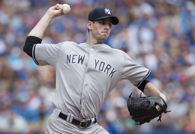 New York Yankees starting pitcher Brandon McCarthy works against the Toronto Blue Jays during the first inning of a baseball game in Toronto, Sunday, Aug. 31, 2014. (AP Photo/The Canadian Press, Darren Calabrese)