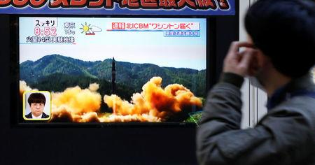 A man looks at a street monitor showing a news report about North Korea's missile launch, in Tokyo, Japan, November 29, 2017.  REUTERS/Toru Hanai