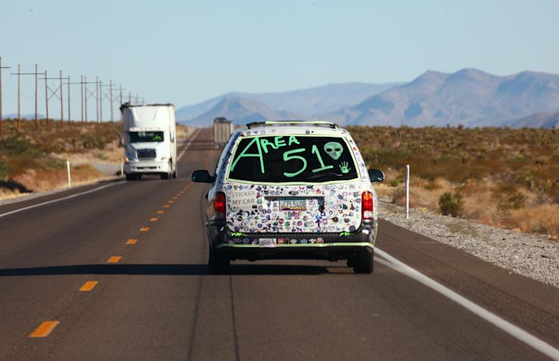 A car drives with 'Area 51' written on the back before the start of a 'Storm Area 51' spinoff event called 'Area 51 Basecamp' on Sept. 20, 2019 near Alamo, Nevada. (Photo: Mario Tama/Getty Images)