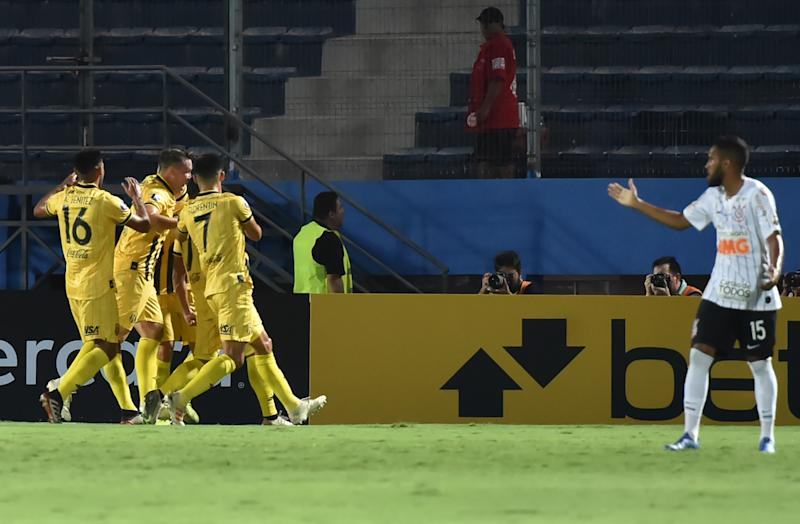 Paraguay's Guarani players celebrate after scoring against Brazil's Corinthians during a Copa Libertadores football match at General Pablo Rojas Stadium in Asuncion on February 5, 2020. (Photo by NORBERTO DUARTE / AFP) (Photo by NORBERTO DUARTE/AFP via Getty Images)