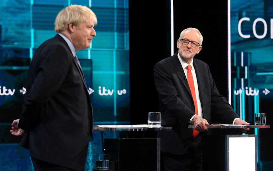 Boris Johnson and Jeremy Corbyn went head-to-head in the first televised debate of the election on ITV. - AFP