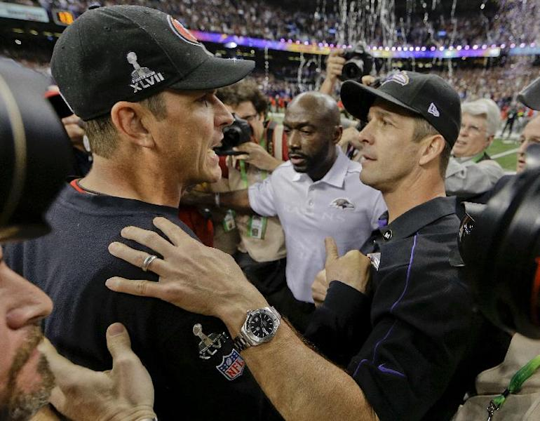 San Francisco 49ers head coach Jim Harbaugh, left, greets Baltimore Ravens head coach John Harbaugh after the Ravens defeated the 49ers 34-31 in the NFL Super Bowl XLVII football game, Sunday, Feb. 3, 2013, in New Orleans. (AP Photo/Dave Martin)