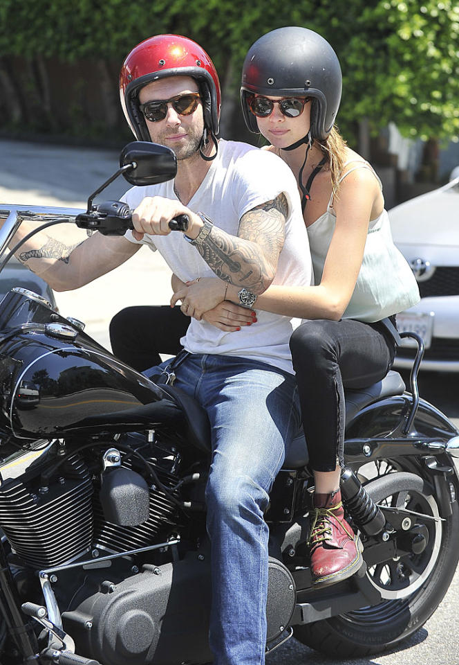 "Adam Levine and new girlfriend Behati Prinsloo (who happens to be, surprise!, a 23-year-old model) took a spin around Hollywood on his classic motorcycle on Thursday. The Maroon 5 singer and his last girlfriend, Victoria Secret model Anne Vyalitsyna split a few months back, but whether or not this love will last remains to be seen. ""I'm fiercely independent, but I'm also terrified of being alone,"" he said in the June issue of <i>Details</i> magazine."