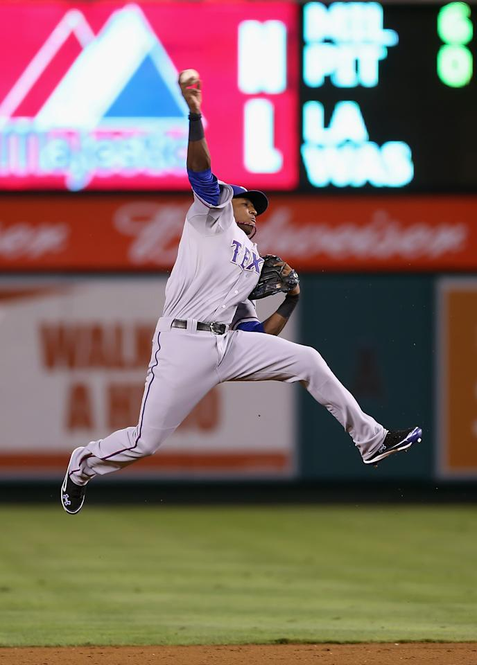 ANAHEIM, CA - SEPTEMBER 18:  Second baseman Jurickson Profar #2 of the Texas Rangers makes a leaping throw to get Kendrys Morales (not pictured) of the Los Angeles Angels of Anaheim out at first in the eighth inning at Angel Stadium of Anaheim on September 18, 2012 in Anaheim, California. The Angels defeated the Rangers 11-3. (Photo by Jeff Gross/Getty Images)