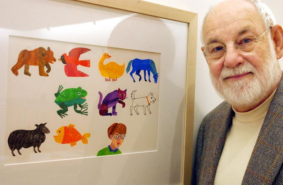 Eric Carle, an illustrator and author of children's books, with a print of some of his illustrations. Carle died on May 23 at age 91. (Photo: Matthew J. Lee for The Boston Globe via Getty Images)