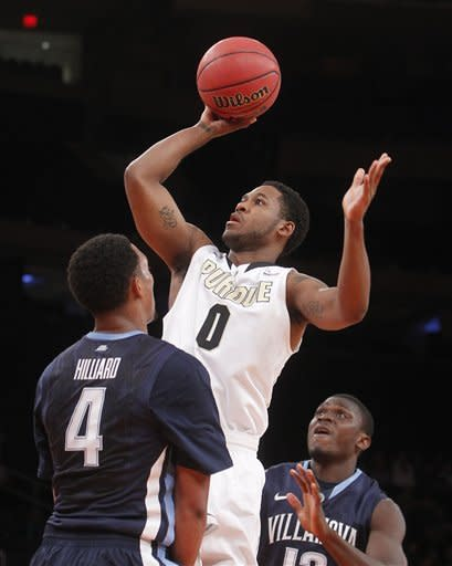 Purdue's Terone Johnson (0) shoots over Villanova's Darrun Hilliard (4) during the first half of their NCAA college basketball game in the 2K Sports Classic at Madison Square Garden, Thursday, Nov. 15, 2012, in New York. (AP Photo/Jason DeCrow)