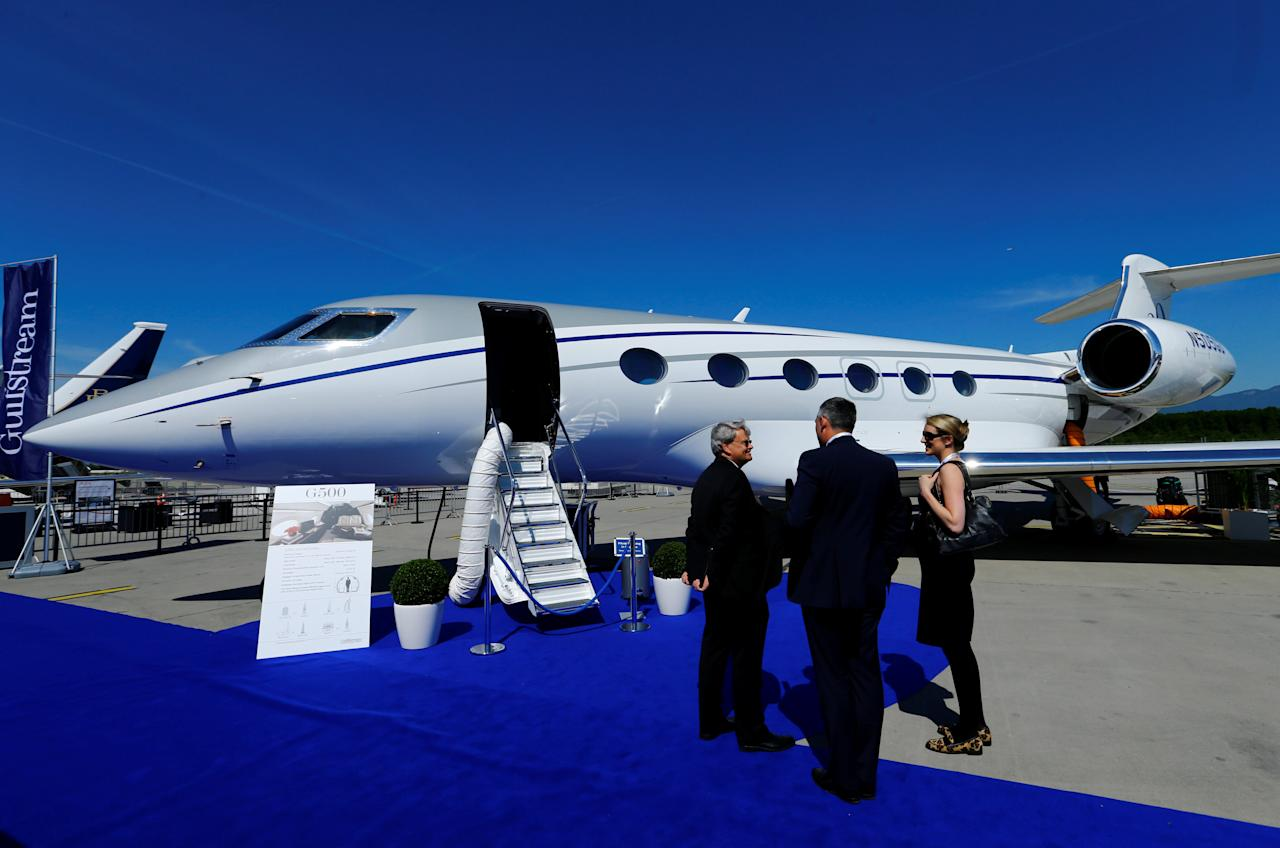 People stand in front of a G500 Gulfstream aircraft during the European Business Aviation Convention & Exhibition (EBACE) at Geneva Airport, Switzerland May 22, 2017. REUTERS/Denis Balibouse TPX IMAGES OF THE DAY
