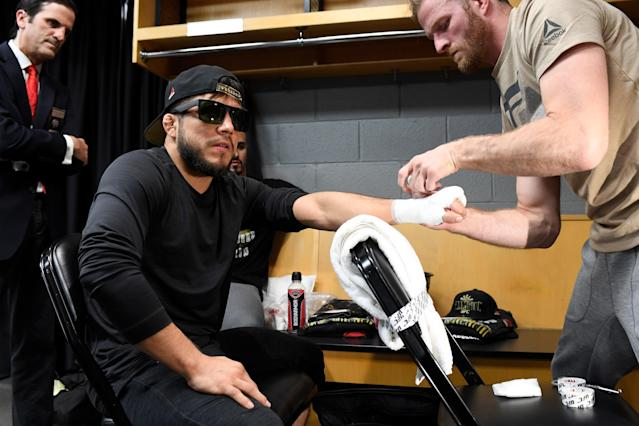Henry Cejudo has his hands wrapped backstage at the UFC 238 event at the United Center by coach Santino Defranco. (Getty Images)
